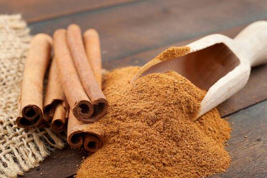 cinnamon-sticks-and-powder-on-wooden-table.jpg