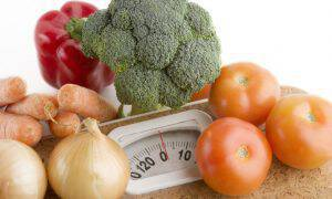 garden vegetables on a bathroom scale