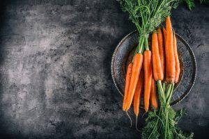 Carrot. Fresh Carrots bunch. Baby carrots. Raw fresh organic orange carrots. Healthy vegan vegetable food. Fresh Vegetable.