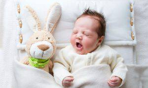 bigstock-Baby-With-Bunny-72269002
