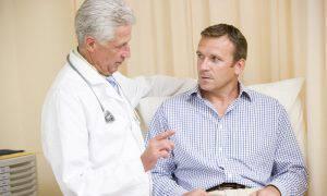 bigstock-Doctor-Giving-Man-Checkup-In-E-4137096