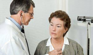 bigstock-Doctor-Listens-To-Patient-s-He-6595894