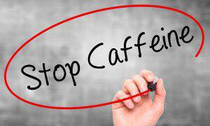 bigstock-Man-Hand-Writing-Stop-Caffeine-118864352