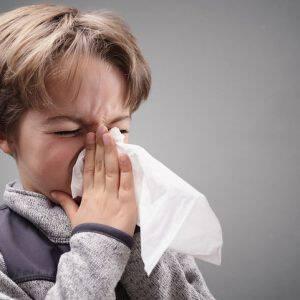 bigstock-Boy-suffering-flu-or-a-cold-bl-116296211