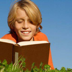 bigstock-Child-Reading-Book-Or-Bible-Ou-2602420