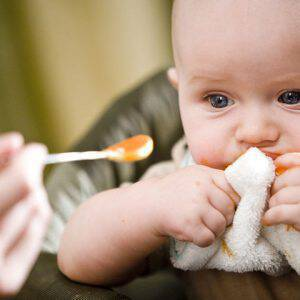 bigstock-Cute-baby-eating-solid-food-fr-6379230