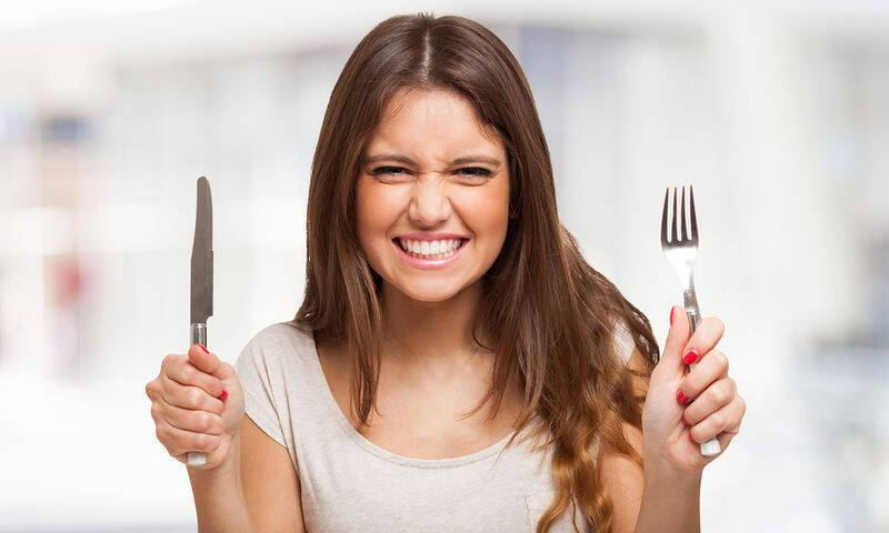 bigstock-Portrait-of-a-very-hungry-youn-60941600
