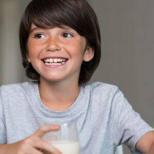 bigstock-Portrait-of-smiling-boy-drinki-110084384