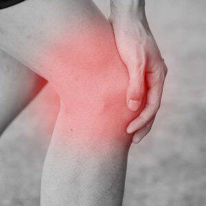 bigstock-Runner-Touching-Painful-Knee-115834571