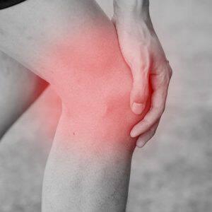 bigstock-Runner-Touching-Painful-Knee-115834571
