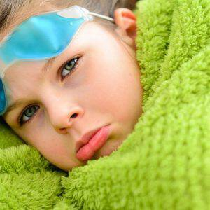 bigstock-Sick-Child-Girl-Under-A-Blanke-87769934