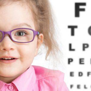 bigstock-Smiling-girl-putting-on-glasse-111310118