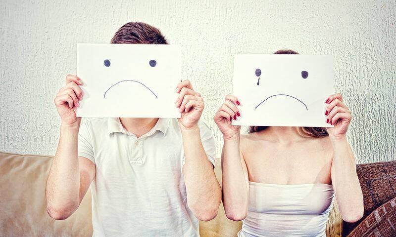 bigstock-Unhappy-Young-Couple-In-Despa-95084669