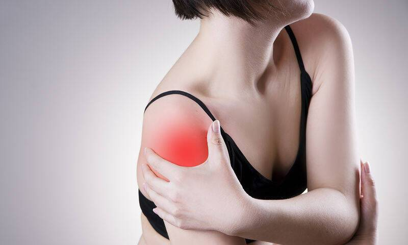 bigstock-Woman-With-Pain-In-Shoulder-P-98597852