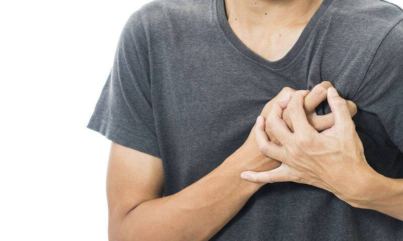 bigstock-man-feeling-heart-pain-and-hol-113045522