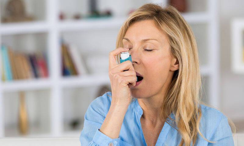 bigstock-woman-with-asthma-using-an-ast-141411584