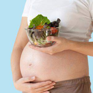 bigstock-Pregnant-Woman-s-Belly-And-Veg-90728213