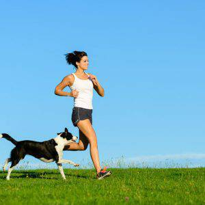 bigstock-Sporty-Happy-Woman-Running-Wit-84410648