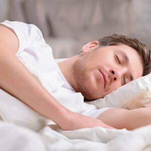 bigstock-Handsome-guy-sleeps-in-his-bed-107391704