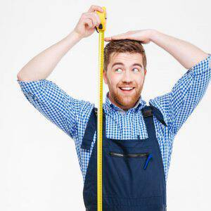 bigstock-Happy-funny-young-man-in-overa-133314356