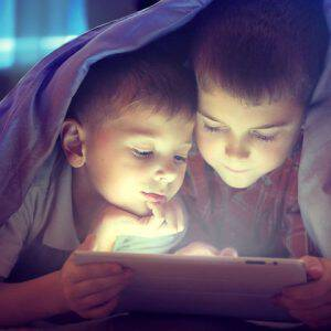 bigstock-Two-kids-using-tablet-pc-under-107656520