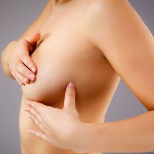bigstock-Woman-examining-breast-38553241