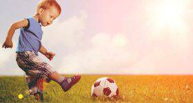 bigstock-Sports-kid-Boy-playing-footba-77211935