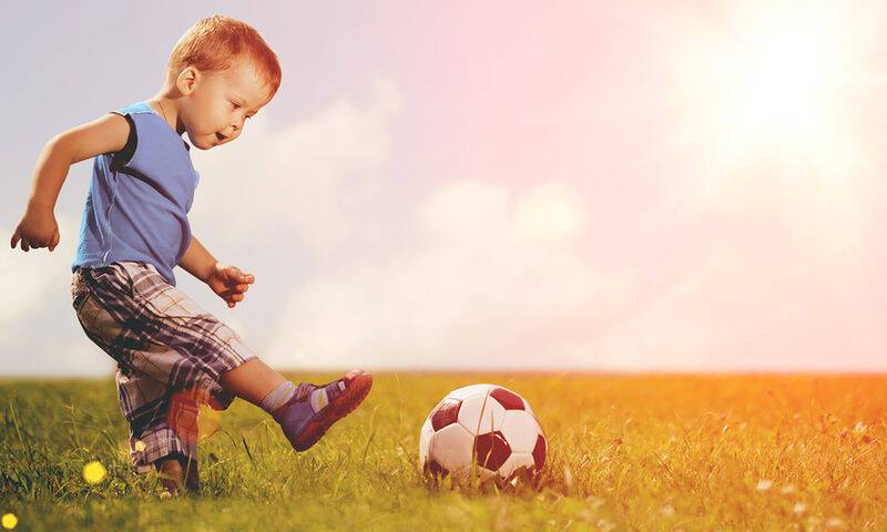bigstock-Sports-kid-Boy-playing-footba-77211935